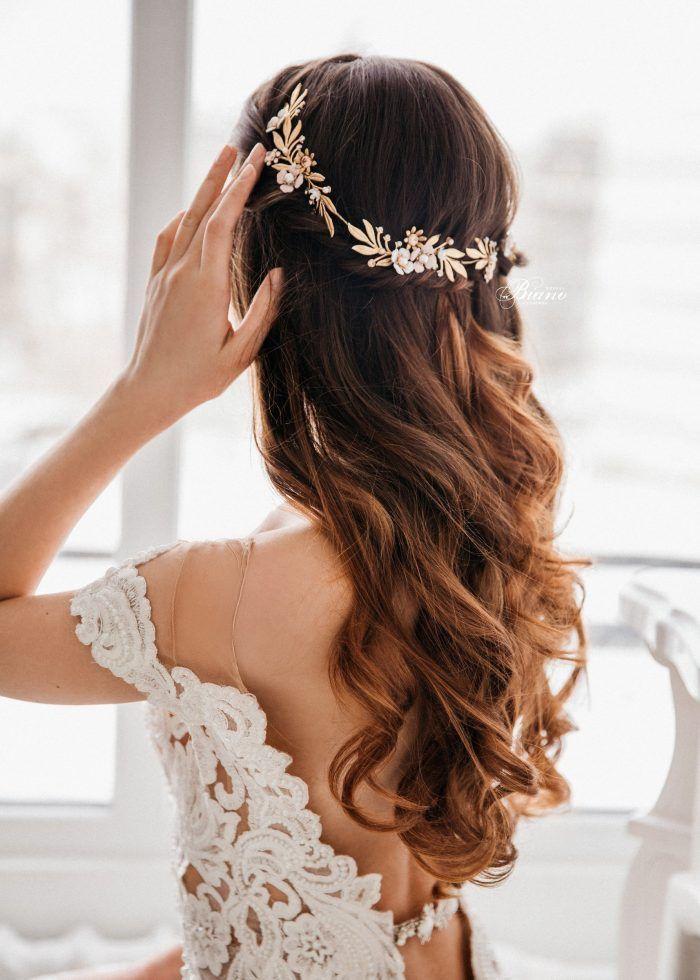 Delicate gold leaf and flower bridal halo | Junebug Weddings