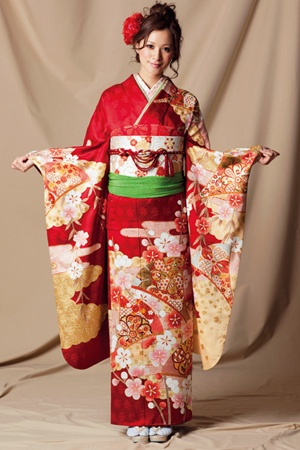 This is called 'Furisode'.This Kimono has a long 'sode'(I mean sleeve),nowadays girls who grownup to 20,wear this and celebrate.  This 'Furisode' design is same as mine.But my 'Obi'(the one looks like a wide belt)is more black design.