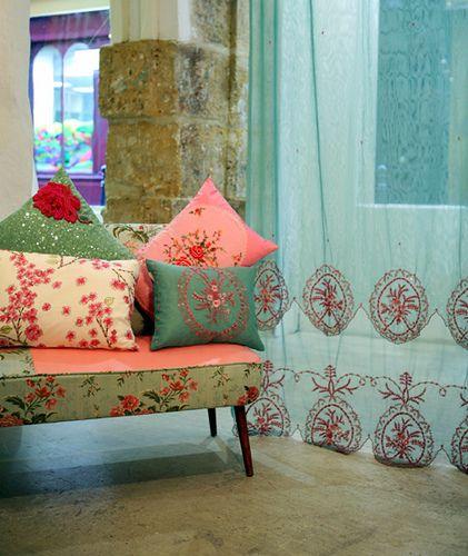 Love the floral pillows and settee