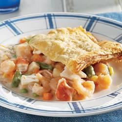 Seafood Pot Pie_  Break into the flaky puff pastry crust and you'll find a delectable pot pie filling packed with shrimp, imitation crab meat and lots of vegetables. Its an impressive dish . . . and only you'll know how easy it is to make! — Campbells Kitchen