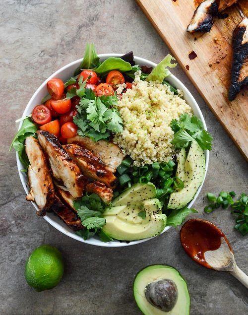 Greens, cilantro, green onions, bbq chicken, avocado, cherry tomatoes, quinoa. Add ranch :)