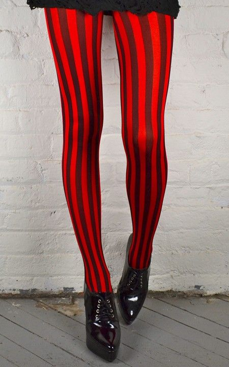 The verticle lines on these tights make the woman's legs seem longer and leaner. This style accomplishes makin the woman seem tall, too.