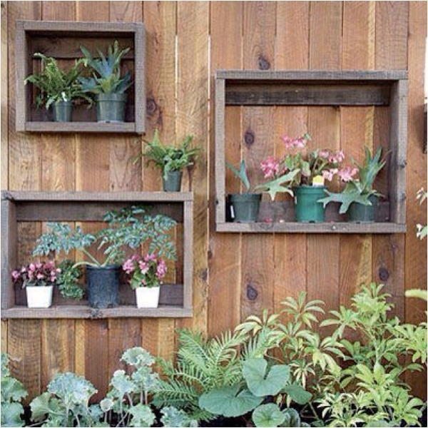 Cute......make a picture frame for your fence and put plants in it!  ~Backyard Divas~