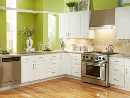 Love the white cabinets with the green backdrop!!