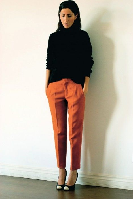 orange cropped wool pants. black heels with white toes.