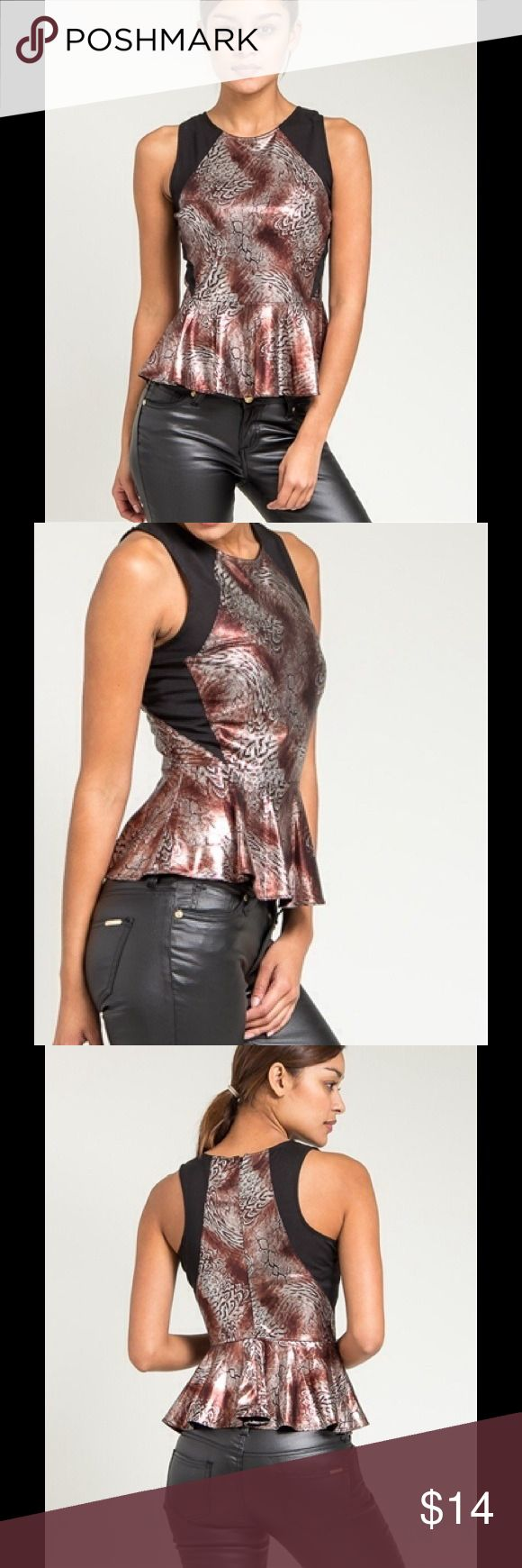 Copper Metallic Peplum Top The super flattering peplum silhouette streamlines this feminine metallic copper print top.  Features black sides to further slim your figure and a back zipper.  Show off your wild side with some faux leather leggings and booties or dress up your office look with a pencil skirt and a crop jacket. Tops