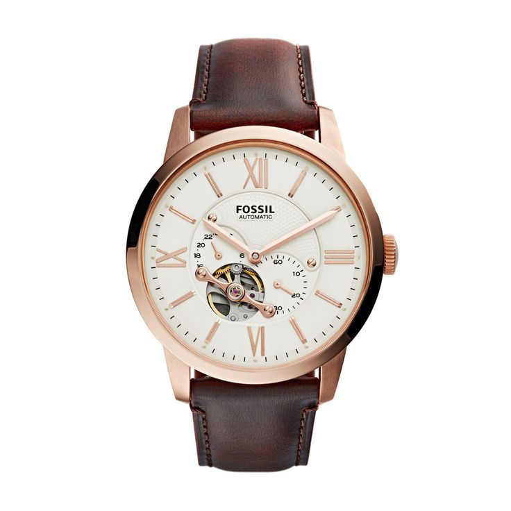 Stainless steel case with a brown leather strap. Fixed bezel. White dial with rose gold-tone hands and Roman numeral hour markers. Minute markers around outer rim. Two sub-dials displaying 24 hour and