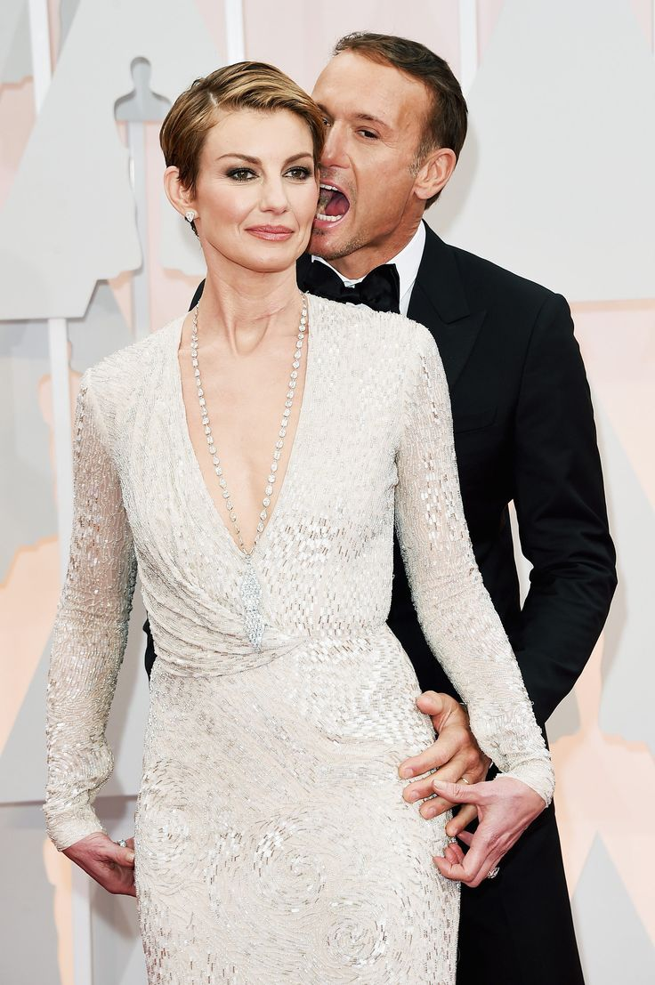 Tim McGraw and Faith Hill bring their love to the red carpet at the 87th Academy Awards.