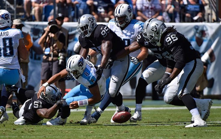 Bruce Irvin #51 of the Oakland Raiders causes quarterback Marcus Mariota #8 of the Tennessee Titans to fumble during the first half at Nissan Stadium on September 25, 2016 in Nashville, Tennessee.  (Photo by Frederick Breedon/Getty Images)