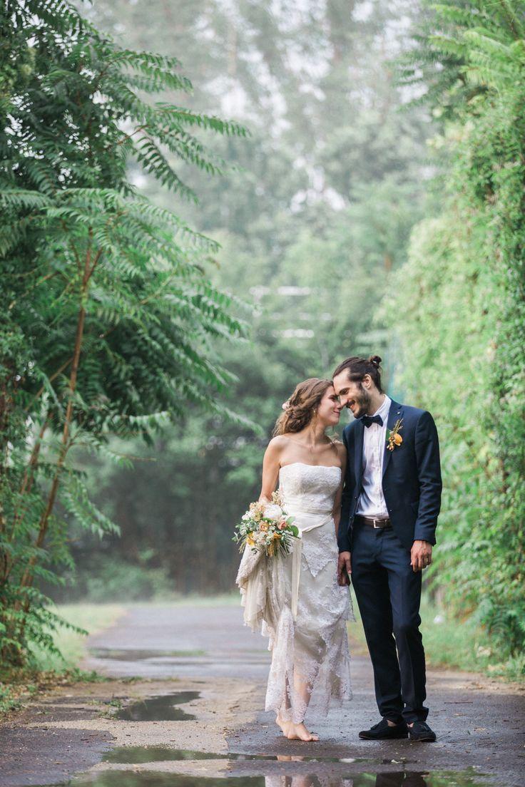 Rainy wedding day couple pose