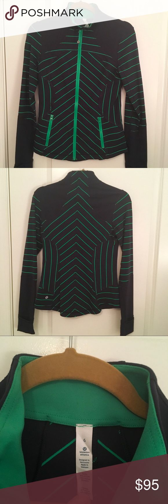"""Lululemon Define Jacket green/navy 6 Excellent condition! No marks or wear. Navy blue and kelly green Define jacket in women's 6. Fitted shape, very flattering design, and unique color combination. Thumb holes and """"cuffins"""" at the wrist. Luon material. Clean and ready for a new home! (I just don't have enough coordinating items in my wardrobe to justify keeping it.) lululemon athletica Tops Sweatshirts & Hoodies"""