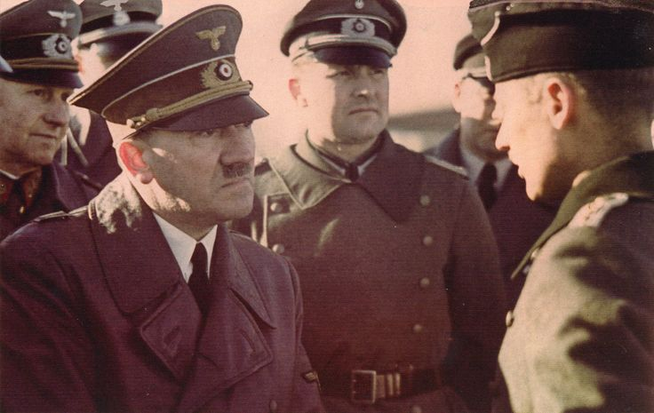 Adolf Hitler hears the report of a front line officer. Behind Hitler, on the left - General Alfred Jodl, right - Hitler's adjutant, Major Gerhard Engel. Most probably 1939.