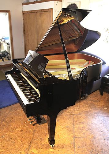 A 1996, Boston GP178 II grand piano with a black case and spade legs at Besbrode Pianos. Keyboard lid features a slow fall mechanism. Piano has an eighty-eight note keyboard and a three-pedal lyre. Designed by Steinway and Sons.