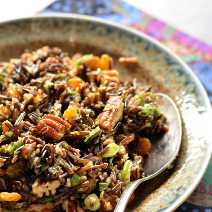 Nutted Wild Rice Recipe Side Dishes with vegetable stock, wild rice, pecan halves, golden raisins, orange, orange, chopped fresh mint, green onions, olive oil, kosher salt, ground black pepper