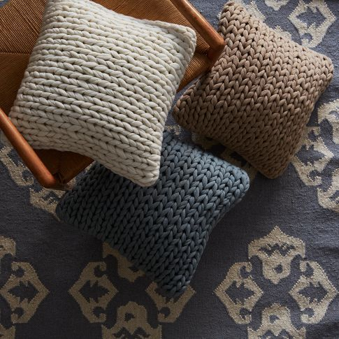 Great look!  I bet I could knit these myself... Sweater Knit Pillow Cover | west elm