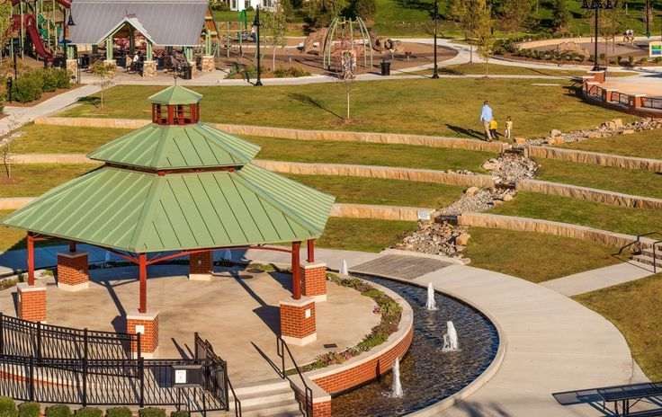 Dardenne Prairie City Hall Park // Dardenne Prairie, Missouri // SWT Design >> The water feature from the spray ground is repurposed by activating a dry stream that bisects the amphitheater.