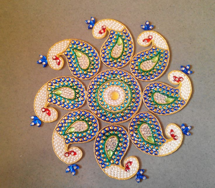 Peackock Rangoli. This is the original design by Vidya Deshpande. If anyone is interested in buying this beautiful rangoli, please comment here. :)