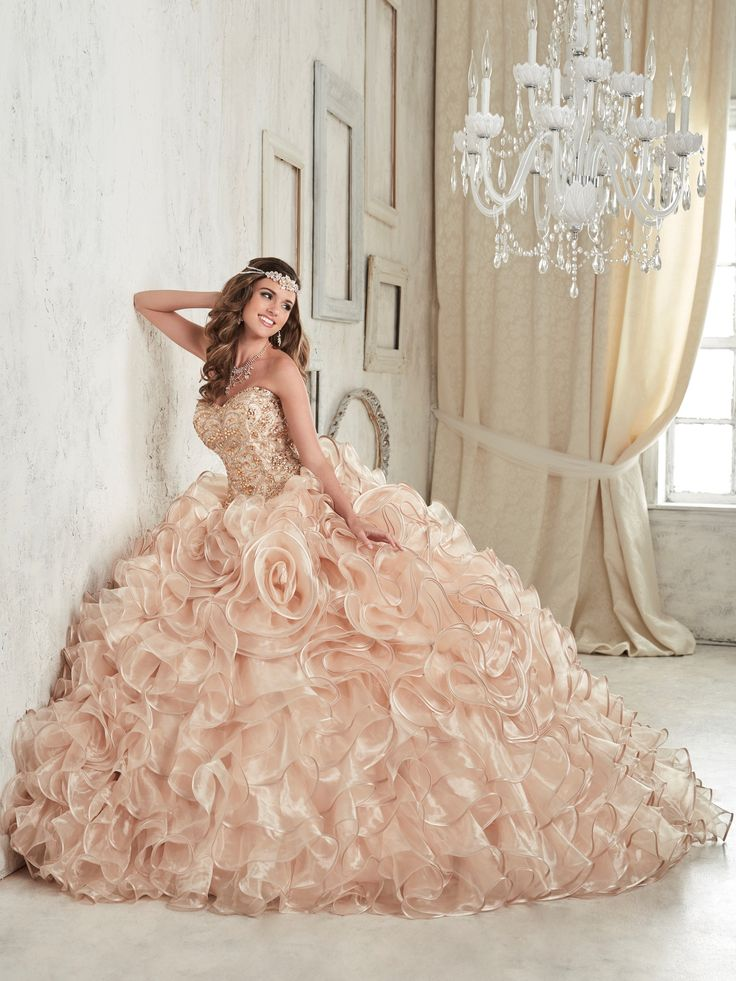 Look elegant in a House of Wu Quinceanera Dress Style Number 26839 during your Sweet 15 party or any formal event. Crafted with thick clusters of colorful rhinestones on the sweetheart bodice, this go