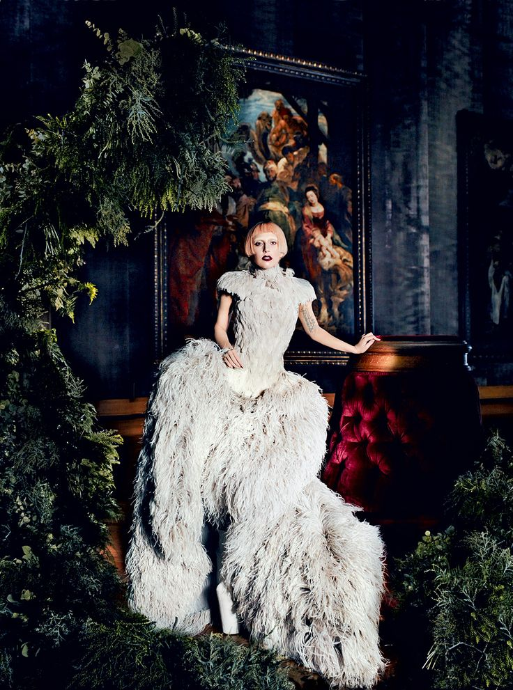 """Lady Gaga: WILD THING - VOGUE    """"I am quite down-to-earth for such an eccentric person,"""" she says.Alexander McQueen pale-gray duck-and-ostrich-feather dress.In this story: hair, Orlando Pita for Orlo Salon; makeup, Linda Cantello at Joe Management for Giorgio Armani Beauty. Shot on location at the Royal Museum of Fine Arts, Antwerp."""