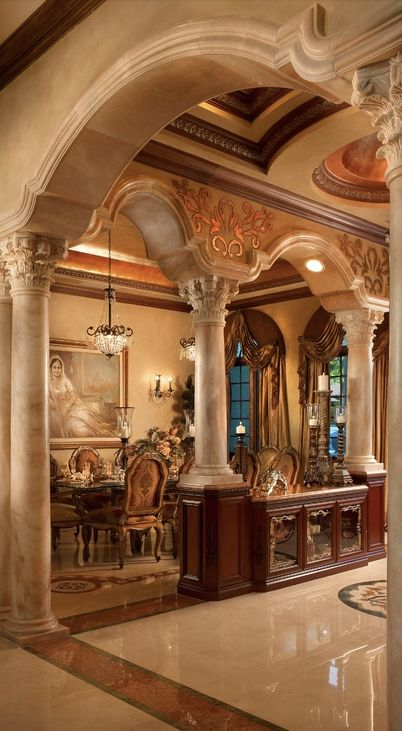 formal dining rooms with columns. display/buffet divider between formal dining and living rooms in houston mediterranean home. with columns d