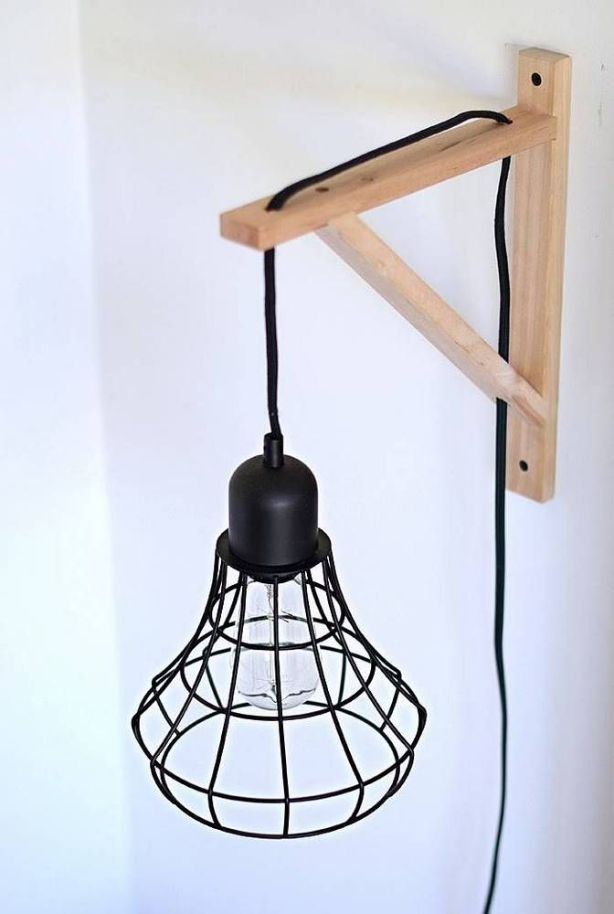 DIY Cage Light Sconces Turn EKBY VALTER brackets into modern light holders for any pendant you choose.  This is a great solution for standard plug-in lights that don't wire into the ceiling
