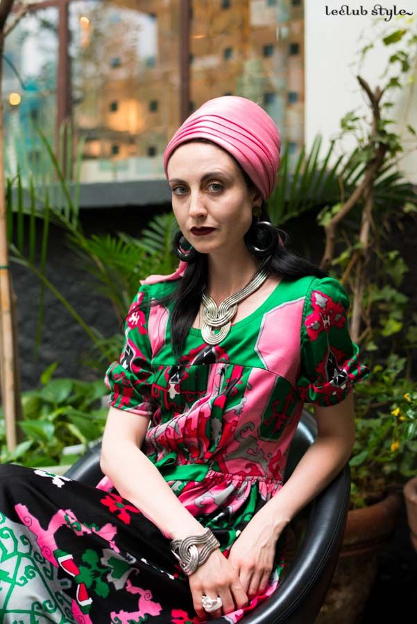 Street Style portraits by Ángel Robles. Fashion Photography from Paris Fashion Week.  Woman at 10 Corso Como wearing a pink turban and colorful silk printed dress. Portrait, Milano.