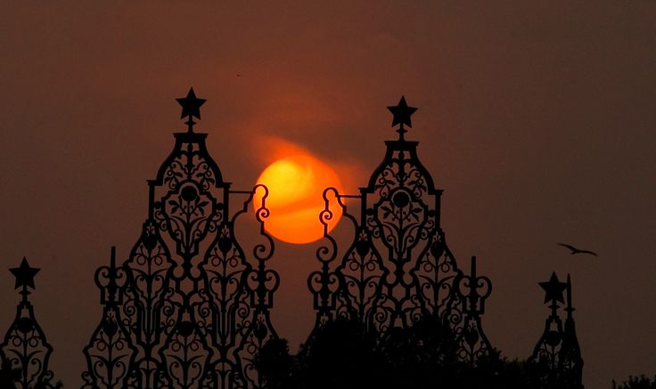 Sun sets over the Indian presidential palace, in New Delhi, India, Wednesday, June 22, 2011. (Manish Swarup/Associated Press)