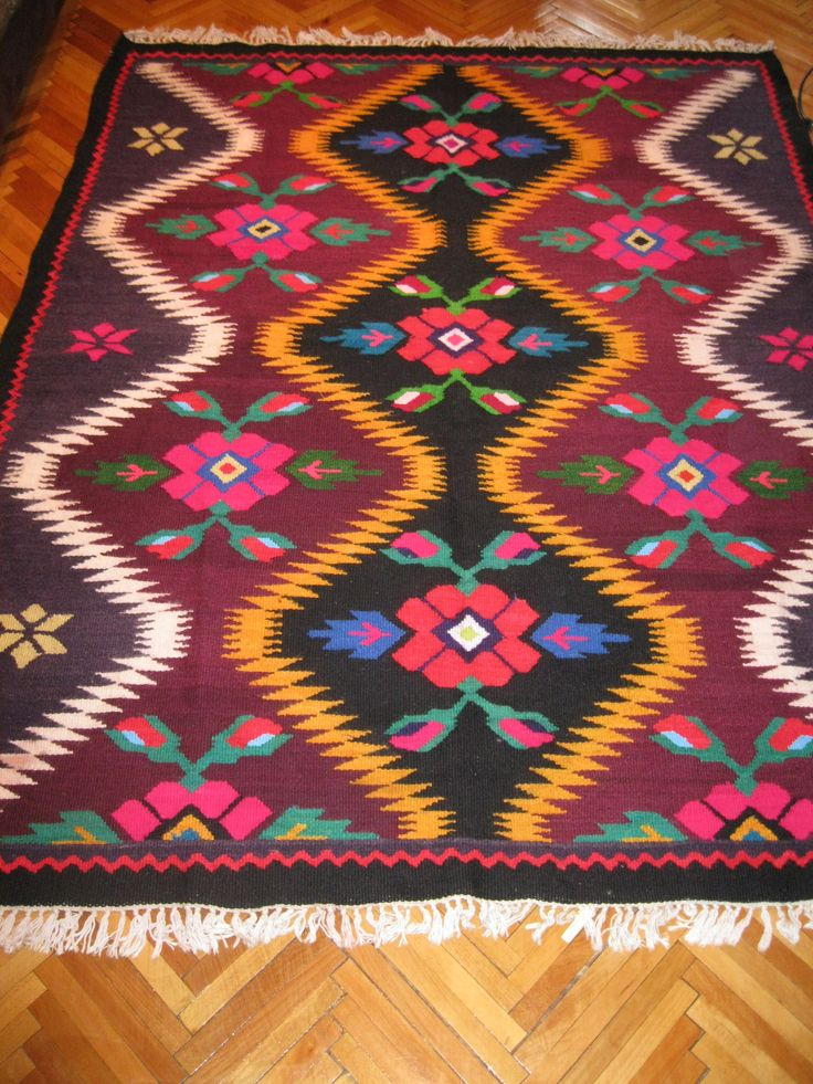 Beautiful antique traditional Romanian / Ukrainian woven wool carpet / rug with both floral and geometrical pattern. Absolutely stunning and vivid colors. Hand woven in Romanian villages closed by Ukrainian borders where are living both Romanians and Ukrainians together, 50 - 60 years ago. Hand woven with wool on cotton thread foundation. For sale at www.greatblouses.com