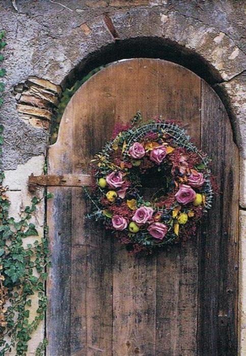 rose wreath of arched wooden door