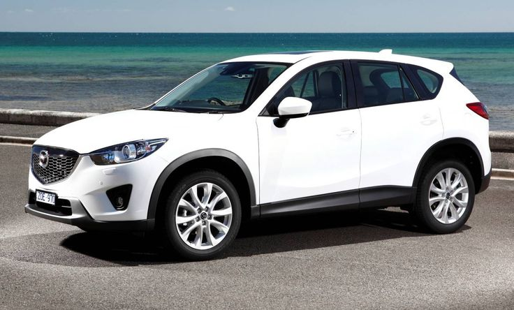 White Mazda CX-5 near the ocean Zo een hebben we nu (even) teleen gekregen , Super Auto