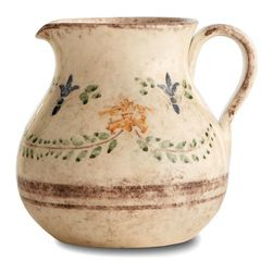 Medici Pitcher - Detailed with subtle, natural fleur-de-lis designs, stylized draping vines, and handsome bands, the Medici Pitcher has been glazed to emphasize the rounded, pleasant silhouette. Its warm colors offer fresco impressions, while the motifs of the adornment are distinctively Mediterranean, creating an inviting and hospitable feel when you fill it or display it on the table.