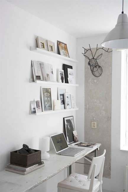 great studio. make a small room bigger with thin wall shelves (great for changing out pics/inspiration boards). interesting wire taxidermy on colour blocked wall section