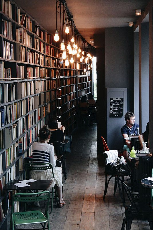 "Afternoon at ""Merci"". Paris. // Create your own library cafe at home with a wall of books in a room with good windows, a small table and chairs, and a few Hudson Valley Lighting Heirloom pendants [not pictured]. After all, Paris is A Moveable Feast. 