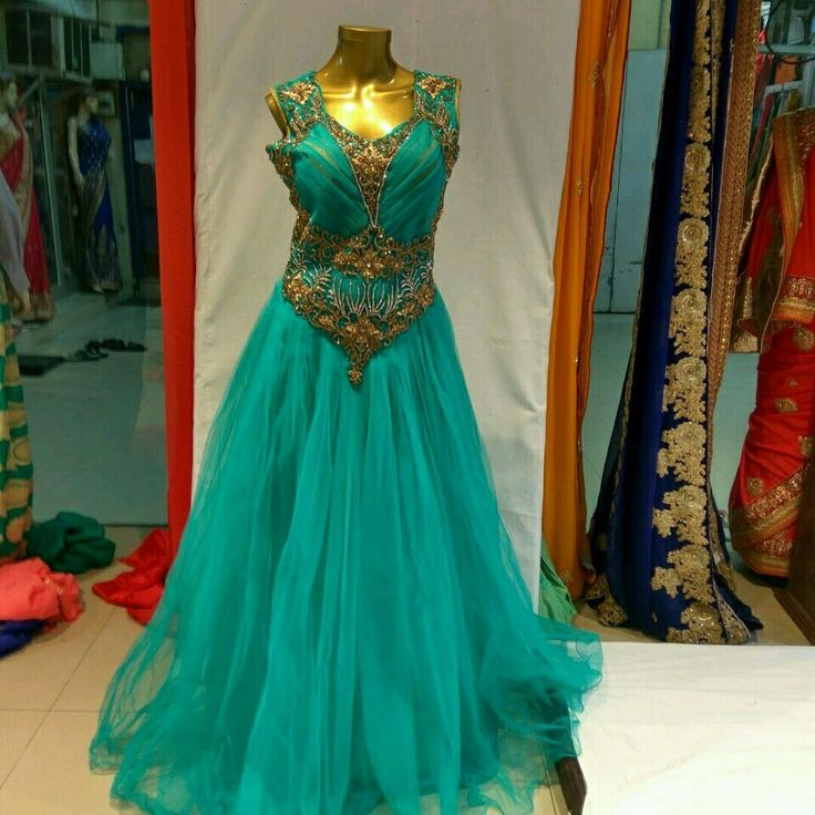 designer indo western gowns available at indiantrendz ethnic wear store pathankot. this firozi net gown with nice hand work available also at rent. www.indiantrendz.com