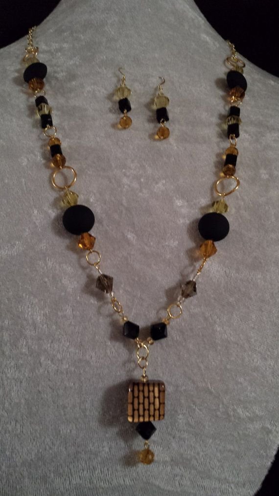 Hey, I found this really awesome Etsy listing at https://www.etsy.com/listing/171813174/gold-and-black-pendant-jewelry-set
