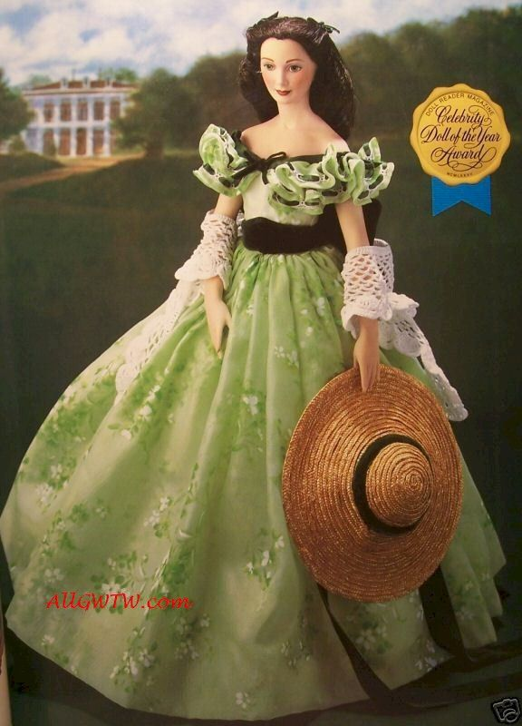 """Scarlett at The BBQ Porcelain Doll Scarlett is dressed in her off the shoulder Green Sprigged Dress that she wore to the BBQ at Twelve Oaks, where she stole the hearts of all of the men including Rhett Butler! This original 1980's Limited Edition Retired 19"""" tall Porcelain Doll is in excellent 'displayed only' condition complete with stand, shawl, straw hat, original box, and COA. Original box is in good/fair condition. If you are looking for this doll, email us and we will find one for you!"""