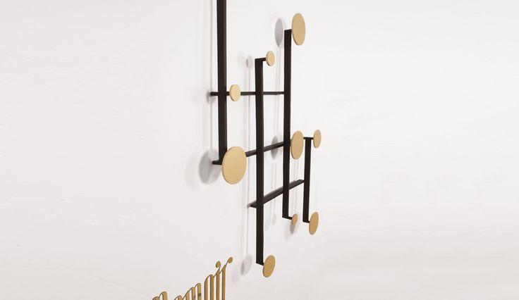 http://images.dopo-domani.com/media/catalog/product/d/a/dante-memoir-accordion-coat-rack-3_1.jpg