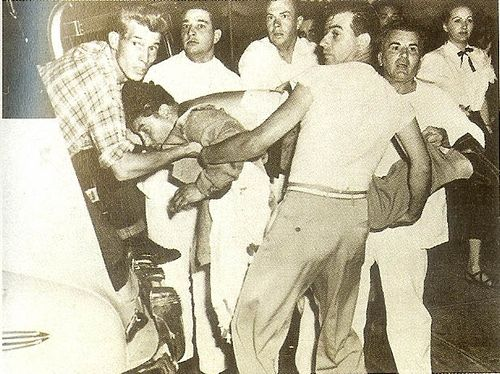 neddie herbert ambulance | Neddie Herbert being placed in the ambulance after the failed hit attempt on Mickey Cohen