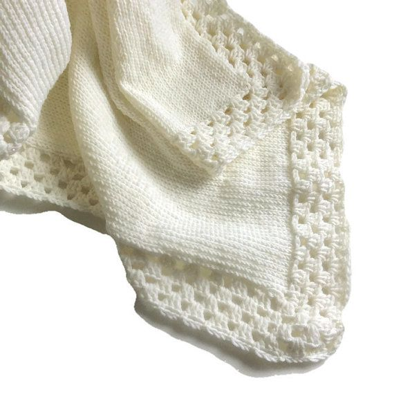 This handmade knitted baby blanket is the heart of my shop. Warm and Woolly began by making these baby blankets in 2010. As my original design, this blanket perfectly combines the vintage charm and modern elegance that founded Warm and Woolly.  It is our belief that each baby is a gift to be celebrated. This blanket is now available in soft merino wool to wrap your little one in luxurious warmth. It is designed to serve your family as a lasting family keepsake for years to come. Enjoy…