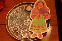 Paper doll and fancy platter from India