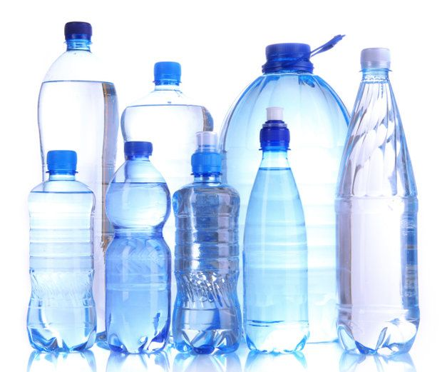 Different water bottles isolated on white