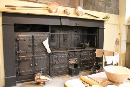 Per chance you ever feel cooking in this modern day is difficult, A. ;)   The Victorian kitchen at Powderham Castle, near Exetor, Devon. The wood fired range.