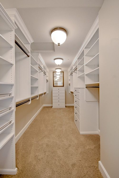 Master closet layout - room 7x22 open wall in the back for a framed wedding dress