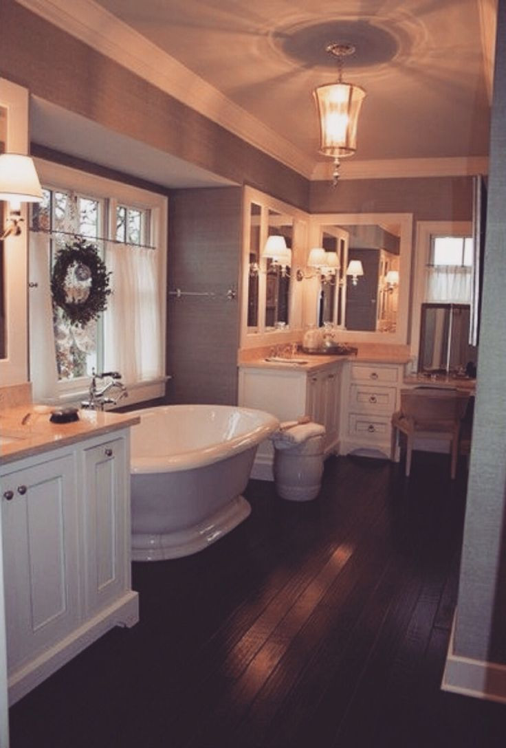 in my dream home i would have a big bathroom like this with plenty enough room for bathing dressing hair and makeup not to mention storage space