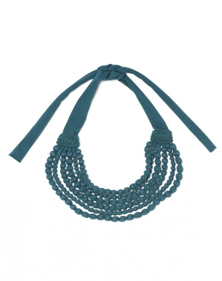 Ожерелье круглое многослойное из деревянных шариков, обтянутых эластичным хлопком. Регулируемая застежка на бантик.