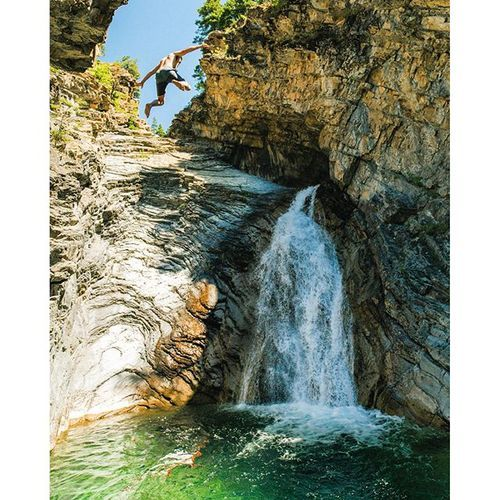 #LiveInsideThePostcard ...You preach it, you live it! Thanks @namkcaps for scaling some sketchy cliffs to catch this one! #waterfall #cliffjumping #experiencewaterton #mywaterton @travelalberta #explorealberta #explorecanada #getoutside #getoutthere #awolmag #lifeofadventure
