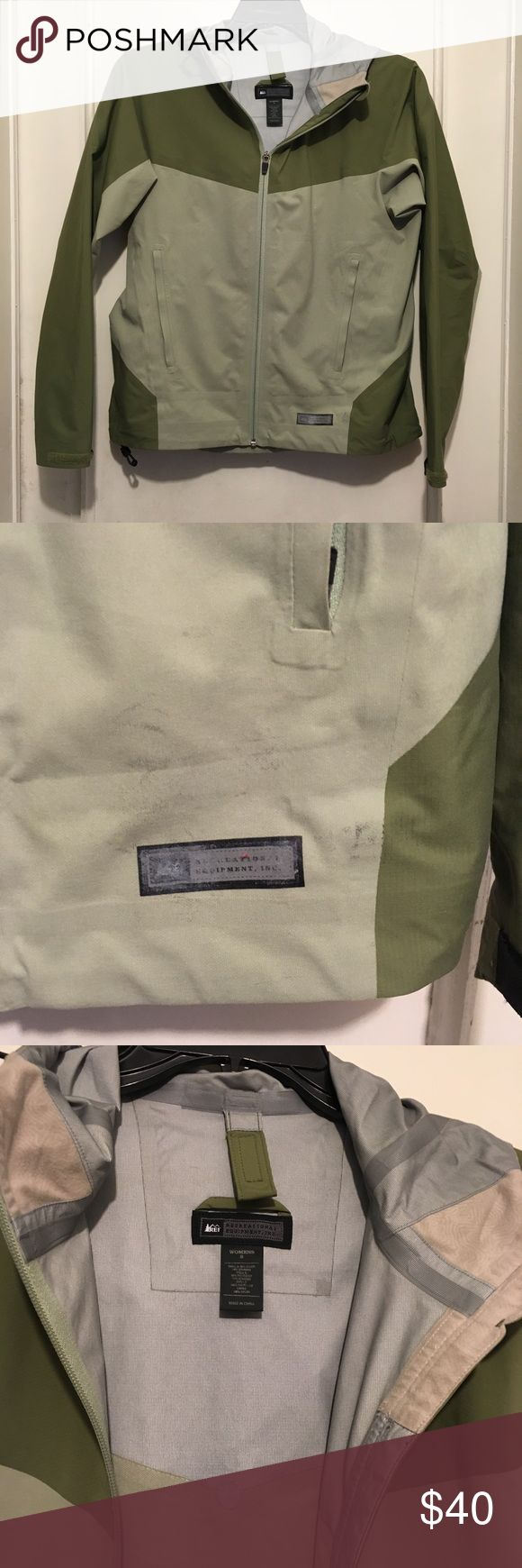 REI Co-op Green Outdoor Windbreaker Rain Jacket S Good lightly used condition. A nice jacket for the transition into fall. One flaw to note: there is a greyish smudge on the left bottom corner right above the front tag. Men's version is shown in stock photo. REI Jackets & Coats Utility Jackets