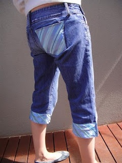 take pants, make them into capris and trim edges and cover a pocket with fabric from a cute patterned tie