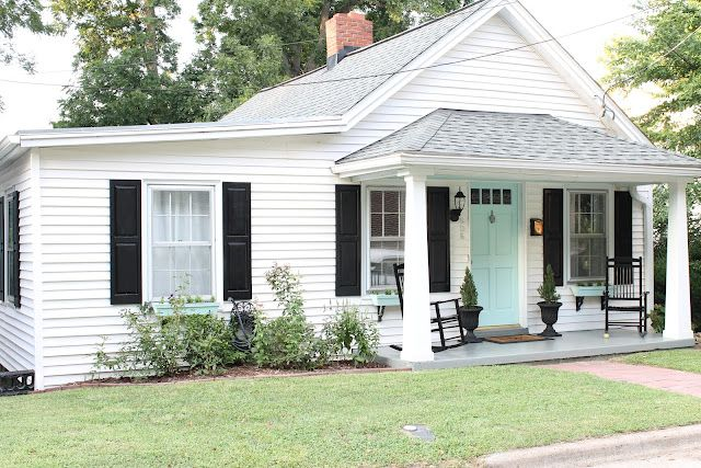 Black Shutters Painted Brick Striped Awnings Topiaries