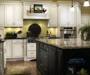white distressed cabinets and black island by MichelleLa